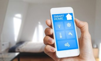 hand holding phone for home automation lead